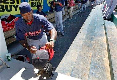 Red Sox outfielder Jackie Bradley Jr. picks up his cap and glove during an exhibition game Friday against Minnesota in Fort Myers, Fla. Bradley Jr. has shown the potential to be Boston's newest phenom, but only time will tell if he's the real deal.