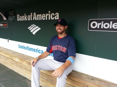 Brian Abraham sits in the dugout at Camden Yards, well after his preparation for the night's upcoming game began.