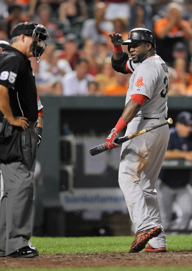 Boston Red Sox designated hitter David Ortiz has words with home plate umpire Tim Timmons after a called third strike in the seventh inning of a baseball game against the Baltimore Orioles, Saturday, July 27, 2013, in Baltimore. Ortiz was later ejected from the game. The Red Sox won 7-3. (AP Photo/Gail Burton)