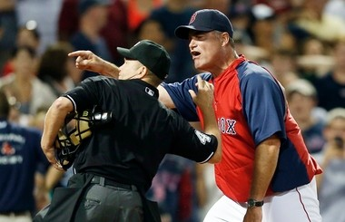 Home plate umpire Jerry Meals, left, ejects Boston Red Sox manager John Farrell in the eighth inning of a baseball game against the Tampa Bay Rays in Boston, Monday, July 29, 2013. The Rays won 2-1. (AP Photo/Michael Dwyer)