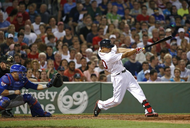 Mookie Betts hits a two-run home run in the fifth inning against the Chicago Cubs at Fenway Park on Wednesday, July 2, 2014. (AP Photo/Elise Amendola)