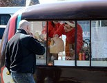 04.04.13 -- Northampton -- MassLive.com photo by Mandy Hofmockel -- Max Reichert passes food to a customers from The Chanterelle To Go food cart parked on Elm Street next to Smith College buildings Thursday.