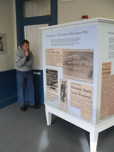 11.09.2013 | HYANNIS -- Tom Johnson, of Melrose, looks at an exhibit on President Kennedy's summer White House in Hyannis Port. (Photo by Kris Deburro / The Republican)