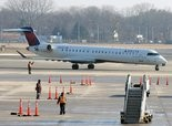 1/17/14 Windsor Locks - Republican Photo by Mark M.Murray- A Delta Connection plane makes its way to the gate at Bradley Airport.