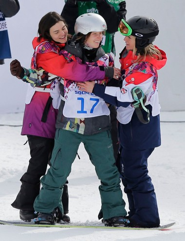 Czech Republic's Sarka Pancochova, center, is embraced by Britain's Jenny Jones, right, and Switzerland's Sina Candrian after Pancochova crashed heavily during the women's snowboard slopestyle semifinal at the 2014 Winter Olympics Sunday.