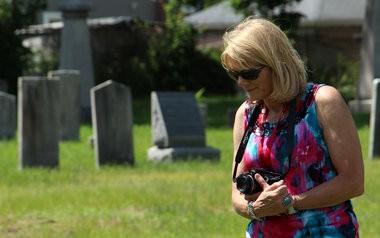 Cindy Gaylord walks through the Old Burying Ground June 26 in Westfield.