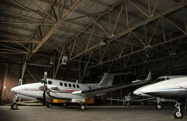 Planes sit in hangar two July 3, 2014, at Westfield-Barnes Airport.