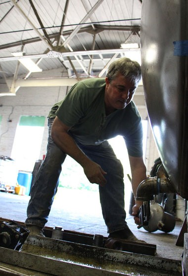 ReEnergizer owner Peter McAvoy works on a tank Tuesday, July 8, in Westfield.
