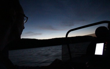Dan Clark, Natural Resources Director with the DCR Division of Water Supply Protection, pilots a boat across Quabbin Reservoir Thursday, July 24, 2014.