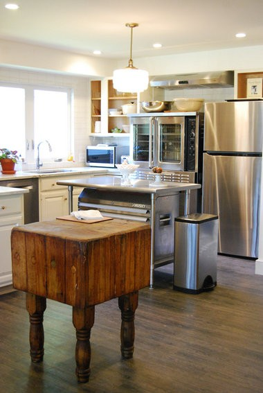 Antique butcher block and stainless steel appliances.