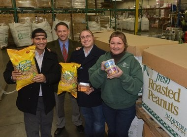 Roberto Morales, production supervisor, snack mix (left), Patricia Maione, inventory specialist, (right) stand with Shawn Hemingway, employment supervisor with the Hampden County Sheriff's Department, and Matthew Venezuela, plant manager for Hampton Farms at 180 Avocado St. in Springfield (JOHN SUCHOCKI / THE REPUBLICAN)
