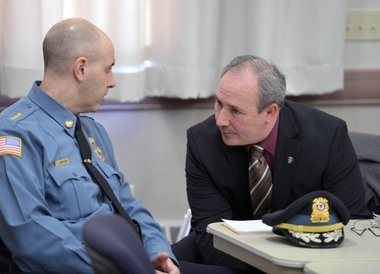 """Officials from UMass and the town of Amherst met with members of the media at Amherst town hall to discuss plans for the annual """"Blarney Blowout"""" coming up on March 7. Here is UMass Police Chief John Horvath (left) talking with Amherst Police Chief Scott Livingstone. (Don Treeger / The Republican)"""