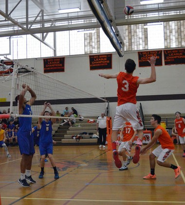 Leclerc plays volleyball for Agawam High School. He wears his signature flag socks and red, white and blue shoes for each game.
