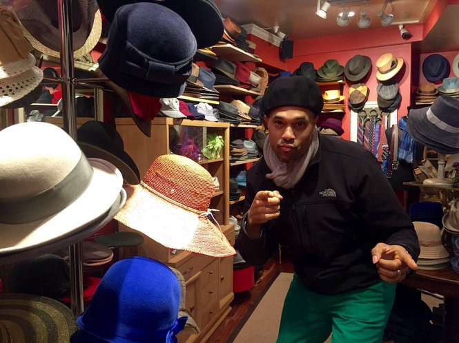 ca950ee7fc3 Emmai Alaquiv tries on hats at Salmagundi s Salem Street shop in Boston s  ...