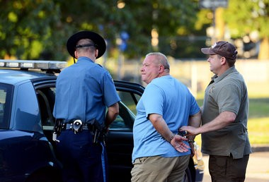 Frank Depergola is led to a cruiser at the Massachusetts State Police barracks in Springfield early Thursday morning, Aug. 4, 2016.