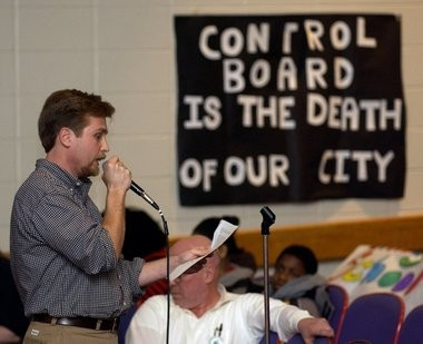 """A Central High School teacher reads a statement during a """"speak out"""" event organized by the teacher association at Central High School in Springfield in March 2005."""