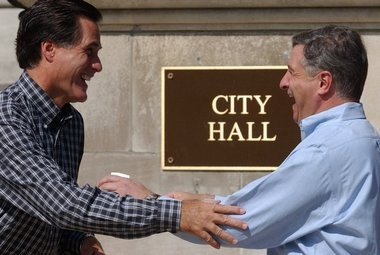 W. Mitt Romney, left, is greeted by Springfield Mayor Michael J. Albano outside Springfield City Hall during a stop on his campaign for governor in September 2002.