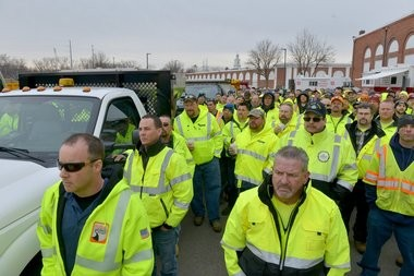 DPW workers from around the region paid tribute to Warren P. Cowles when his funeral services were held Friday, March 24, 2017. Here, they gather on the grounds of the Eastern States Exposition in West Springfield.