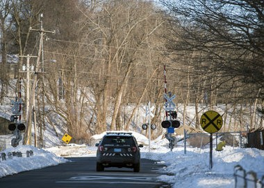 """The railroad crossing at Emerson Road in Longmeadow has what are known as """"active"""" signals, including lights and gates."""