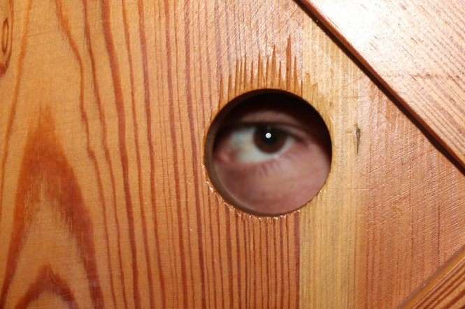 The peep hole at the speakeasy Less Than Greater Than.