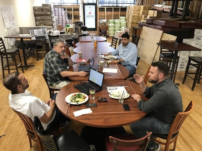 Joe Grafton of Rethink Restaurants and Henry Patterson of Foodservice Strategy meet with two of the partners at Rail Trail Flatbread Co., Michael Kasseris and Jason Kleinerman.