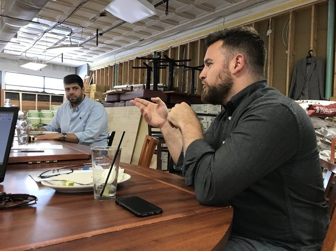 Jason Kleinerman (right) and his business partner Michael Kasseris hold a meeting in a planning room off Rail Trail Flatbread Co.