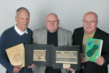 From left, Ken Kindig and Ernie LaBranche, both of West Springfield, and Agawam's Allan Collins proudly display their Peanut Bowl memorabilia.