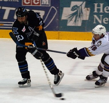 Bryan Helmer gets off a pass during a game against Manchester in 2004 in his previous incarnation as a member of the Springfield Falcons.