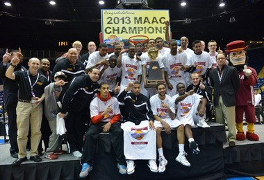 The Iona men's basketball team celebrate their MAAC Championship victory Monday at the MassMutual Center.