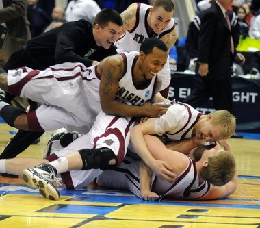 Members of the Bellarmine basketball team celebrate their NCAA Division II national championship at the MassMutual Center in 2011.