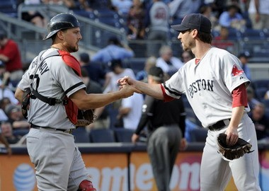 Red Sox pitcher Craig Breslow, who will be honored by the NECBL in November, is congratulated by catcher Ryan Lavarnway after Boston beat the Yankees Sept. 7 in New York.