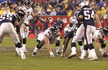Mike Flynn, a 1992 graduate of Cathedral High School, lines up on the offensive line for the Ravens during a game in New England in November 2004.