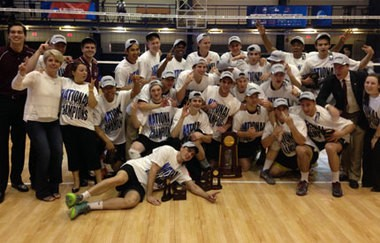 The Springfield College men's volleyball team celebrates its national title Sunday.l