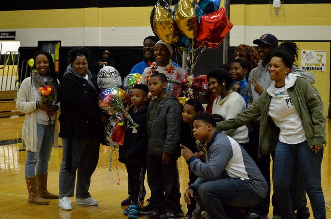 Sharon Robinson (center), shown here on her senior night, said playing for the Central basketball team helped prepare her to go on to Westfield State. (MEREDITH PERRI / MASSLIVE)