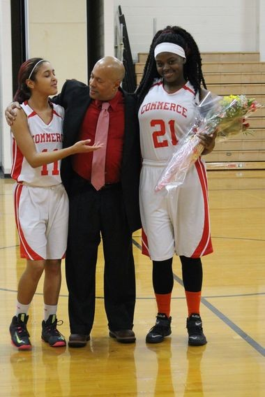 Jayzabel Torres (left) and Alexus Anderson stand with their coach, Skip May. (SUBMITTED PHOTO BY SOPHIE MARKHAM)