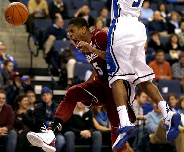 Jesse Morgan screams in pain as he collides with Saint Louis guard Kwamain Mitchell during the second half Thursday.