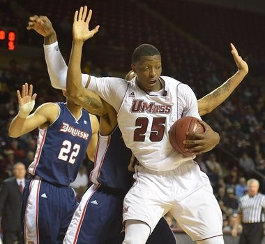 UMass forward Cady Lalanne, pictured here against Duquesne on Jan. 17, has seen his performance markedly improve since his 12-day suspension.