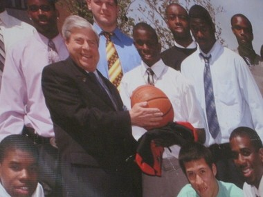 A poster of Chaz Williams and the rest of his tea meeting Brooklyn Borough President Marty Markowitz hangs in the gym at Bishop Ford High School.