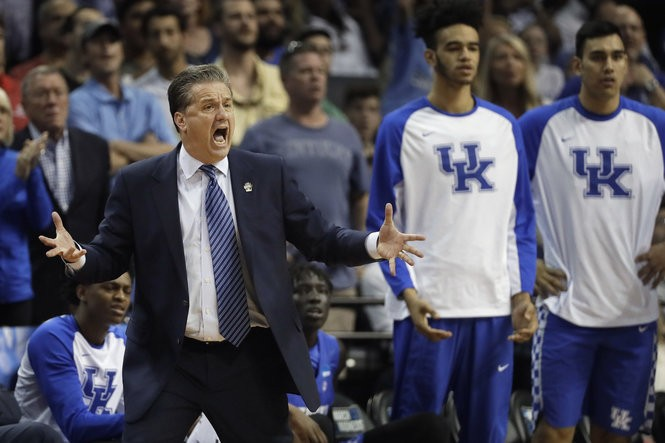 106387ae1b9d Calipari finally let everyone touch his hair after winning the NCAA title