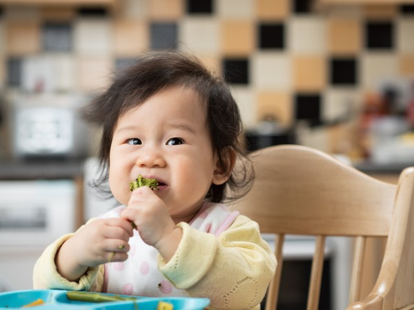 Allowing baby to feed herself is a great way to encourage healthy habits early on.