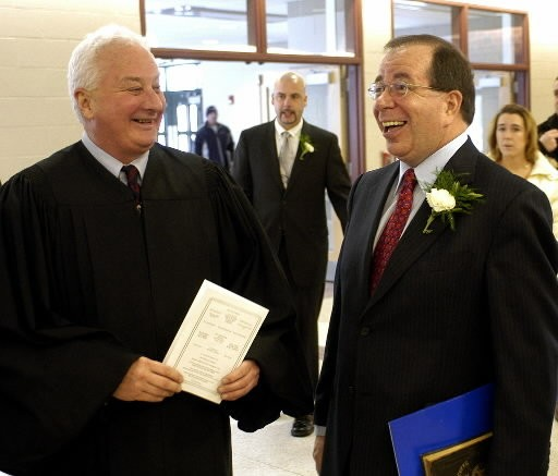 Judge Robert F. Kumor shares a moment with Mayor Bissonnette prior to swearing in ceremony at Chicopee High in this 2006 file photo.