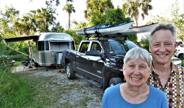 Deborah and Richard Bangham of Easthampton stand in front of their truck, kayaks and RV at Collier-Seminole State Park outside Naples, Florida, early this month.