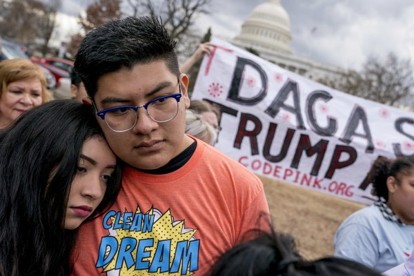 In this Jan. 23, 2018, file photo, immigration advocates hold a rally on Capitol Hill in Washington. The U.S. Supreme Court on Monday, Feb. 26, 2018, denied the Trump administration's unusual request to overrule a judge who kept alive a program that shields young immigrants from deportation. (AP Photo/Andrew Harnik, File)