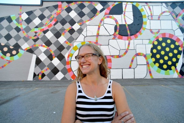 Easthampton-based artist Kim Carlino has created a mural on the side of the Gifford Lock bulding on Lyman Street in downtown Springfield. Funded through a City Public Art program made possible from a Community Development Block Grant, the giant mural is an abstract depiction of history of the board game in Springfield. (Don Treeger / The Republican)