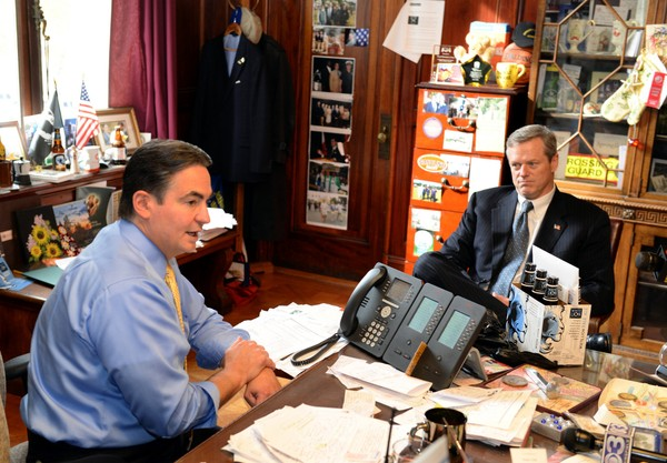 Incoming Massachusetts Governor Charlie Baker, right, seen here with Springfield Mayor Domenic Sarno, is making good on a campaign promise to oppose any cuts to local aid despite a projected $329 million budget shortfall. (MARK M. MURRAY / THE REPUBLICAN)