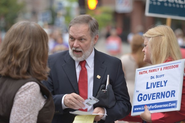 Scott Lively, a Springfield resident who has made an international name for himself through his strong anti-gay positions and statements, is considering a run for Congress following an unsuccessful run for governor in 2014. In this file photo, he stands with supporters ahead of a gubernatorial debate in downtown Springfield. (DAVE ROBACK / THE REPUBLICAN)