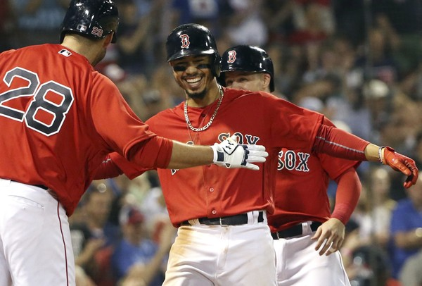 Boston Red Sox's Mookie Betts celebrates with J.D. Martinez (28) after hitting a two-run home run against Atlanta in May. Betts and Martinez are among those selected to play in the All-Star Game in Washington July 17.