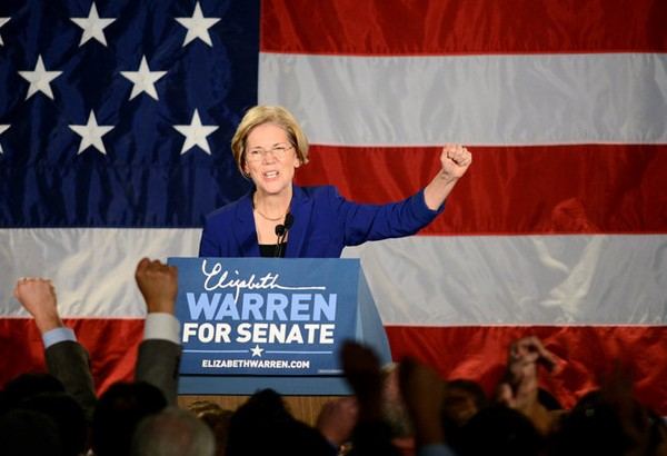 11.06.2012 | BOSTON -- Senator-elect Elizabeth Warren takes the stage at the Fairmont Copley Plaza Hotel Tuesday night. Staff photo by Greg Saulmon.