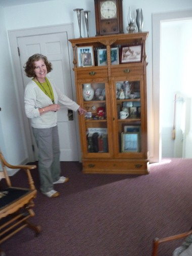 Pastor Jill Forton, of Cascade Christian Church, shows some of the artifacts in the memory room.