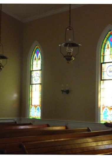 Stained glass windows are distinctive in century plus chapel.